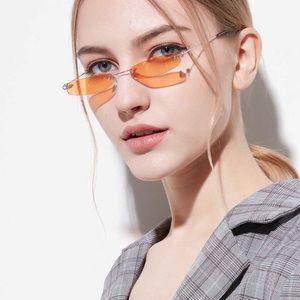 skinny narrow rimless rectangle glasses